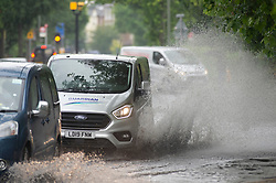 ©Licensed to London News Pictures 17/06/2020<br /> Bromley, UK. Widmore Road in Bromley, South East London is flooded in both direction due to heavy rain. Torrential rain and thunderstorms across large parts of the UK today as the sunny weather takes a break. Photo credit: Grant Falvey/LNP
