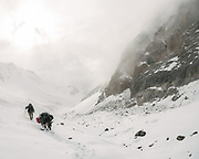 """Going over the challenging Irshad Pass (4950m) into Pakistan. It snowed for 36 hours straight. Guiding and photographing Paul Salopek while trekking with 2 donkeys across the """"Roof of the World"""", through the Afghan Pamir and Hindukush mountains, into Pakistan and the Karakoram mountains of the Greater Western Himalaya."""