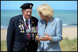 Image ©Licensed to i-Images Picture Agency. The Duchess of Cornwall talks to veteran, Stanley Clark Fields 95, on Juno Beach, Normandy, France, on the eve of the 70th anniversary of D-Day, Thursday, 5th June 2014 Picture by Andrew Parsons  / i-Images