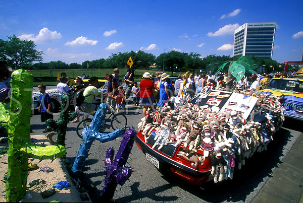 Stock photo of a wildlife car covered with stuffed monkeys