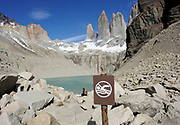 No swimming in the glacial lake. The granite spires of the Torres del Paine from the west looking across the Torres Glacier and its glacial lake from the Mirador Las Torres. Torre Sur is on the left then Torre Central then Torre Nord. The slopes of Monte Almirante Nieto are on the far left and those of Cerro Nido de Condor on the far right. Torres del Paine National Park, Republic of Chile 18Feb13