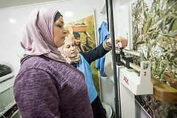 26 February 2020, Abu Dis, Palestine: 43-year-old Intisar Alafandi (left) from Abu Dis  has her weight taken by dietitian Samah Khatib (right) in order to calculate her body-mass index, as she visits the Mobile Diabetes Clinic of the Augusta Victoria Hospital for testing. In an effort to make Diabetes services more accessible to people in the West Bank, the Augusta Victoria Hospital offers a Mobile Diabetes Clinic, which moves around to various locations in the West Bank, offering screening and routine testing for Diabietes and the symptoms it causes.