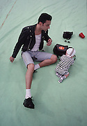 David Gahan and a toddler of Depeche Mode, photographed at Pasadena Rose Bowl, June 1988.