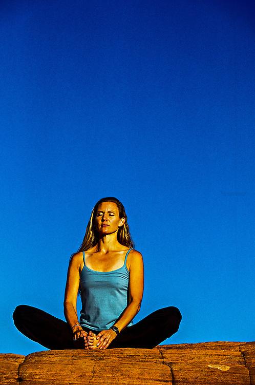 Woman doing yoga, Snow Canyon State Park, Utah, USA