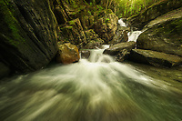 Wide angle image of Preston Brook as it spills over Honey Hollow Falls in Richmond, VT, USA