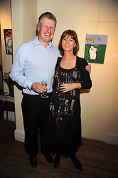 RICHARD & DEBBIE FINCH at an exhibition of Sarah-Jane Boler's paintings entitled 'Life on The Farm' held at The Troubadour, 265 Old Brompton Road, London on 27th November 2008.
