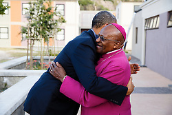 US President Barack Obama greets Archbishop Desmond Tutu as he arrives at the Desmond Tutu HIV Foundation Youth Centre June 30, 2013 in Cape Town, South Africa.