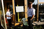 Danny Burrage, a local fireman, is standing in front of his house with Louis, his young son, in BedZED on Thursday, Sep. 6, 2007, in London, UK. BedZED or the Beddington Zero Energy Development, is an environmentally-friendly housing development near Wallington, England in the London Borough of Sutton. It was designed by the architect Bill Dunster who was looking for a more sustainable way of building housing in urban areas in partnership between the BioRegional Development Group and the Peabody Trust. There are 82 houses, 17 apartments and 1,405 square meters of work space were built between 2000. The project was shortlisted for the Stirling Prize in 2003. The project is designed to use only energy from renewable source generated on site. In addition to 777 square meters of solar panels, tree waste is used for heating and electricity. The houses face south to take advantage of solar gain, are triple glazed and have high thermal insulation while most rain water is collected and reused. Appliances are chosen to be water efficient and use recycled water wherever possible. Low impact building materials were selected from renewable or recycled sources and were all originating within a 35 mile radius of the site to minimize the energy required for transportation. Also, refuse collection facilities are designed to support recycling and the site encourage eco-friendly transport: electric and LPG cars have priority over petrol/diesel cars, and electricity is provided by parking spaces appositely built for charging electric cars.