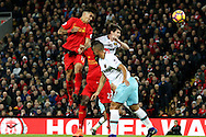 Roberto Firmino of Liverpool (l) gets his head to the ball but heads wide of goal. Premier League match, Liverpool v West Ham Utd at the Anfield stadium in Liverpool, Merseyside on Sunday 11th December 2016.<br /> pic by Chris Stading, Andrew Orchard sports photography.