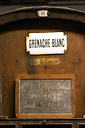 Grenache Blanc, white grenache, VDN Vin Doux Naturel, Appellation Controlee 1976 Rivesaltes. Chateau de Nouvelles. Fitou. Languedoc. Barrel cellar. Wooden fermentation and storage tanks. France. Europe.