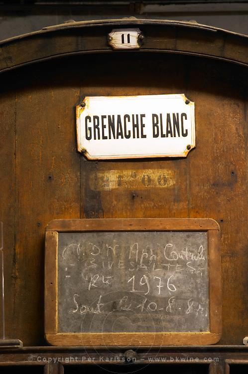 Grenache Blanc, white grenache, VDN Vin Doux Naturel, Appellation Controlee 1976 Rivesaltes. Chateau de Nouvelles. Fitou. Languedoc. Barrel cellar. Wooden fermentation and storage tanks. France. Europe.