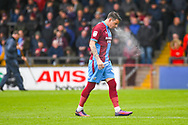 Adam Hammill of Scunthorpe United (47) puffs out a cloud of water before kick off during the EFL Sky Bet League 1 match between Scunthorpe United and Bradford City at Glanford Park, Scunthorpe, England on 27 April 2019.