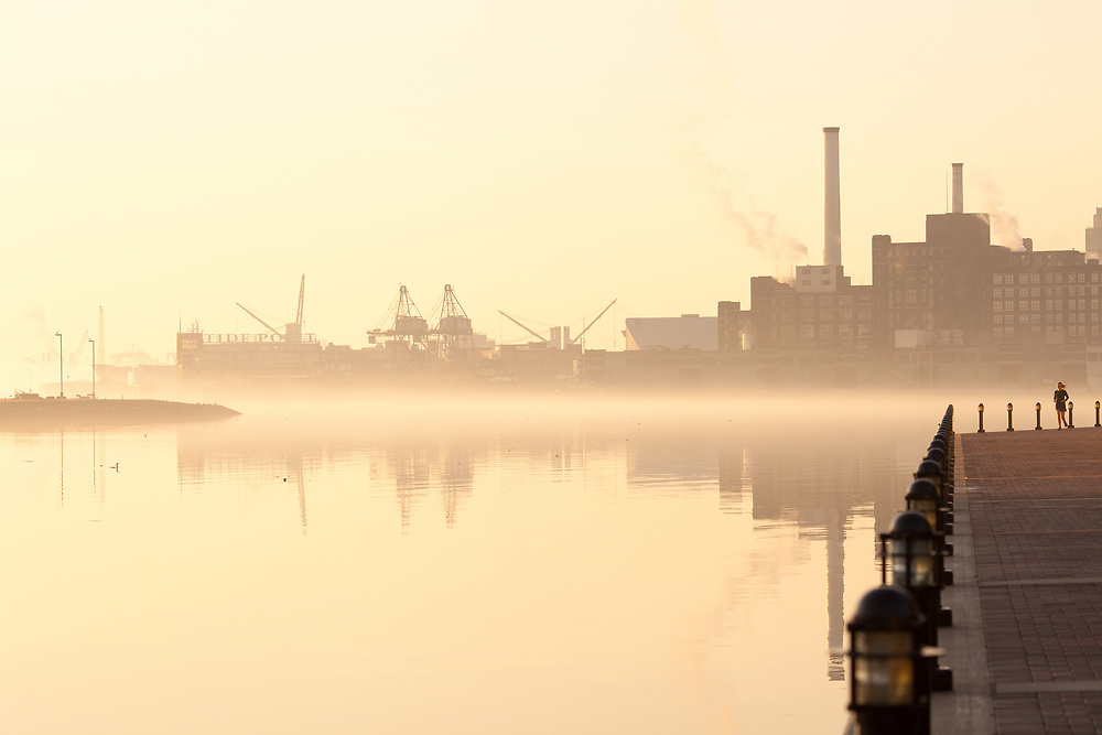 Baltimore, Maryland, United States - Inner Harbor, port facilities and industries at dawn.