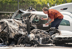 June 30, 2017 - Irvine, CA, USA - Investigators look over a small plane after a crash on I-405 freeway at MacArthur in Irvine, CA. The plane missed the runway at John Wayne Airport and injuries are unknown on Friday, June 30, 2017. (Credit Image: © Ken Steinhardt/The Orange County Register via ZUMA Wire)