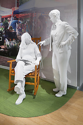 Kaiser Permanente life size plaster sculptures of lifestyle people in diorama