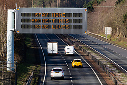 East Lothian, Scotland, UK. 28 March, 2020. Coronavirus lockdown roadside warning sign with message STAY HOME PROTECT NHS SAVE LIVES on A1 highway in East Lothian. Iain Masterton/Alamy Live News