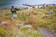 Liana Welty hikes the trail to Horseid Beach from the small village in Kjerkfjorden, Moskenesoya, Lofoten Islands, Norway.
