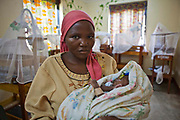 Brenda with her 3-week-old baby using the neo natal facilities at Bwindi Community Hospital.  Her baby was born was 7 weeks premature, due to the carefully planned facilities there is a high chance of survival for all premature babies born at the hospital. <br /> Bwindi Community Hospital is in Buhoma village on the edge of Bwindi Impenetrable Forest in Western Uganda. It serves around 60,000 people from the surrounding area.