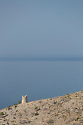 Blue sky over hilltop overlooking tranquil blue sea, Elinda, Chios, Greece
