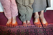 A Wakhi family. They apply Henna on their feet and fingers to protect from the cold. Driving up from Ishkashim town to Sarhad village, the end of the road in the Wakhan corridor.