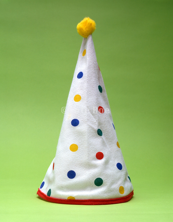 still life of a party hat with bright color dots