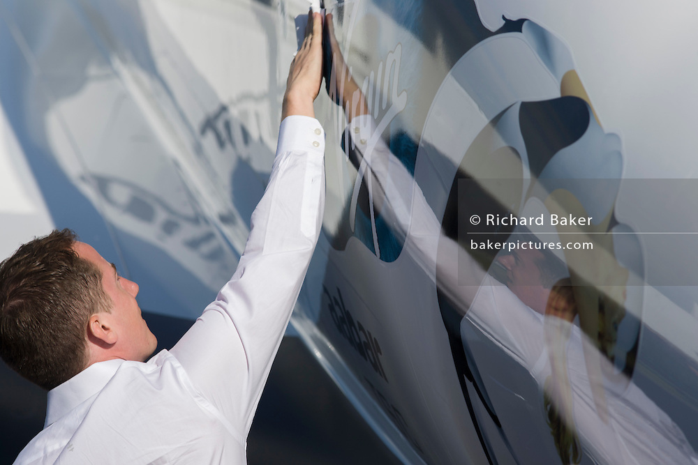 Poishing a model of Virgin Galactic's space tourism vehicle, SpaceShipTwo (SS2) at the Farnborough air show.
