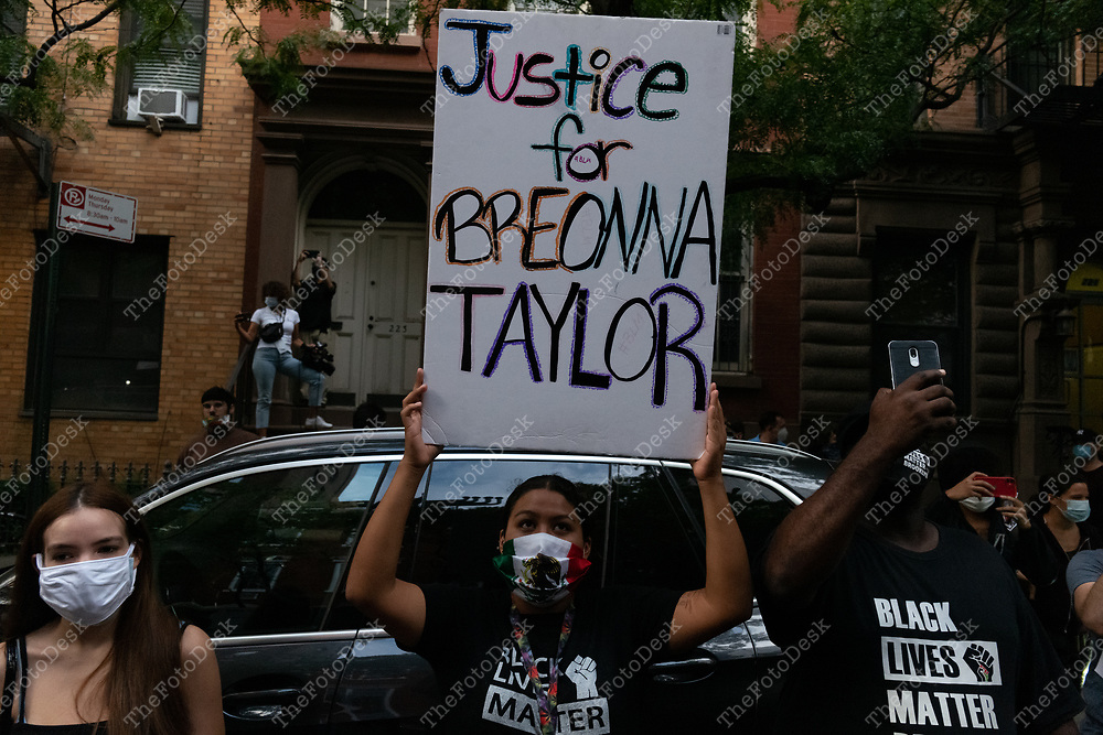 A demonstrator is shown holding a justice for Breonna Taylor sign on West 15th street during a Black Lives Matter rally against Corey Johnson in New York, New  York on Thursday, September 24, 2020. Marchers called on defunding the police as well as criticizing New York City Council speaker Corey Johnson's failure to defund the New York Police Department by $1 billion dollars. A demand that emerged from nationwide anti-police-brutality protests. (©Brian Branch-Price/TheFotodesk)