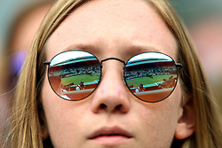 Court one reflected in a spectators sunglasses on day eight of the Wimbledon Championships at the All England Lawn Tennis and Croquet Club, Wimbledon. PRESS ASSOCIATION Photo. Picture date: Tuesday July 10, 2018. See PA story TENNIS Wimbledon. Photo credit should read: Nigel French/PA Wire. RESTRICTIONS: Editorial use only. No commercial use without prior written consent of the AELTC. Still image use only - no moving images to emulate broadcast. No superimposing or removal of sponsor/ad logos. Call +44 (0)1158 447447 for further information.