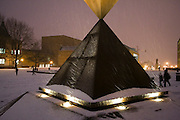 Students at the University of Washington brave the slippery bricks of Red Square during an unusual snow storm in Seattle, Washington on November 27th, 2006.