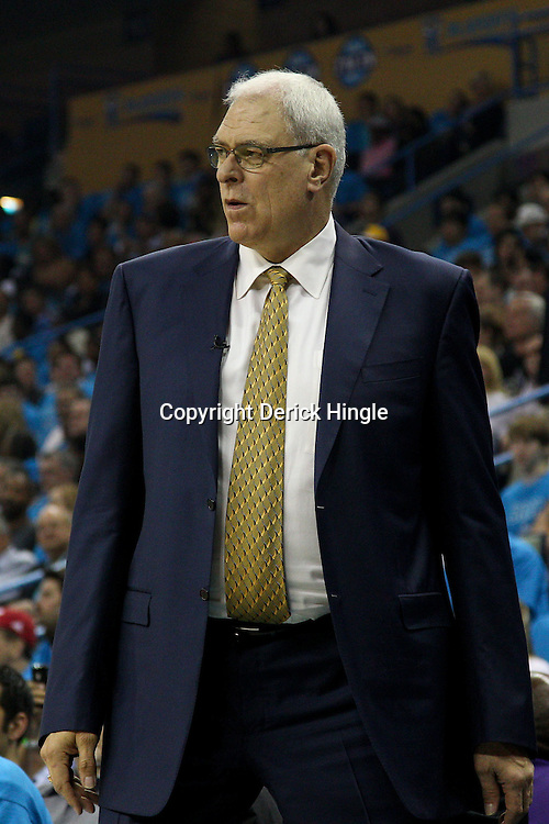 April 28, 2011; New Orleans, LA, USA; Los Angeles Lakers head coach Phil Jackson against the New Orleans Hornets during the first quarter in game six of the first round of the 2011 NBA playoffs at the New Orleans Arena.    Mandatory Credit: Derick E. Hingle