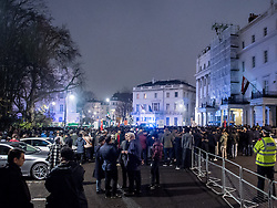 December 13, 2016 - London, London, United Kingdom - Image ¬©Licensed to i-Images Picture Agency. 13/12/2016. London, United Kingdom. Aleppo is Dying Protest. ..Over 1000 protesters gathered outside the Syrian Embassy in London...As well as voicing their anger at the current dire situation for civilians in the war torn city of Aleppo and speaking out against Bashar al-Assad's regime, Muslim prayers were held at the ''emergency demo.'' ..Picture by Pete Maclaine / i-Images (Credit Image: © Pete Maclaine/i-Images via ZUMA Wire)