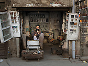 Street scene in and around the Walled City of Lahore. Knife seller.