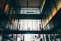 A man walks through an office building in the Ginza business district of Tokyo, Japan.