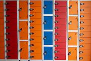 Multi coloured lockers inside the visitors centre at HMP Wandsworth,  London. United Kingdom