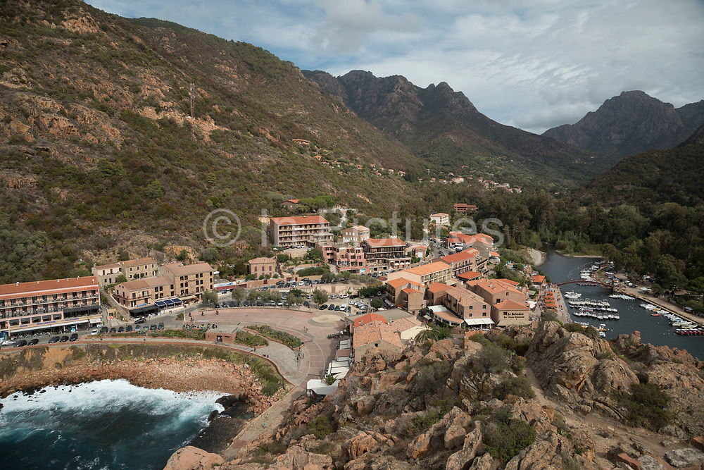 Veiw overlooking the village on 12th September 2017 in Porto, Corsica, France. Porto is a west coast village overlooking the Golfe de Porto, a tourism destination built for that specific reason. It is essentially, a port for tourist boats to moor and leave from and a series of hotels, restaurants and attractions around the beach.