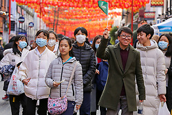 © Licensed to London News Pictures. 01/02/2020. London, UK. A group of Asian people are seen in London's Chinatown wearing face masks following the outbreak of Coronavirus in Wuhan, China. <br /> According to the Department of Health, 203 people have been tested in the UK, with 201 results coming back negative and two positive. One of the two people to test positive for is a student at the University of York. Photo credit: Dinendra Haria/LNP