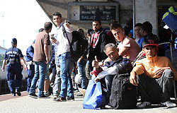 © London News Pictures. 06/09/2015. Migrants wait on a train to take them to Germany or Austria at the train station in Győr close to the border of Hungary and Austria, September 6 2015.  Hundreds of migrants have resumed their journey through Austria to Germany after Hungary's decision on Friday to let them through. Picture by Paul Hackett/LNP