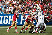 San Francisco 49ers quarterback C.J. Beathard (3) throws a pass as Los Angeles Chargers defensive end Isaac Rochell (98) leaps while trying to knock it down during the NFL week 4 regular season football game against the Los Angeles Chargers on Sunday, Sept. 30, 2018 in Carson, Calif. The Chargers won the game 29-27. (©Paul Anthony Spinelli)