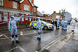 © Licensed to London News Pictures. 09/04/2019. London, UK. Crime scene investigators arrives on Church Road, Manor Park, East London where a man in his 20s was shot and stabbed to death on Monday 8 April 2019. Police were called around 9.30pm and the man was was found with knife and gunshot wounds. The victim was pronounced dead at the scene. Photo credit: Dinendra Haria/LNP