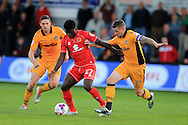 Kabongo Tshimanga of Milton Keynes Dons © holds off Scot Bennett of Newport county ®. EFL cup, 1st round match, Newport county v Milton Keynes Dons at Rodney Parade in Newport, South Wales on Tuesday 9th August 2016.<br /> pic by Andrew Orchard, Andrew Orchard sports photography.