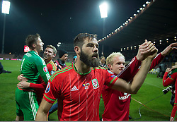 ZENICA, BOSNIA & HERZEGOVINA - Saturday, October 10, 2015:Wales Joe Ledley celebrates after securing a place at next years Euro Championships after the Bosnia & Herzegovina vs Wales match at the Stadion Bilino Polje during the UEFA Euro 2016 qualifying Group B match. (Pic by Peter Powell/Propaganda)