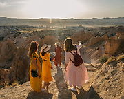Russian tourists enjoy the sunset over Red Valley, Cappadocia.