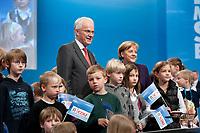 20 MAR 2010, MUENSTER/WESTF/GERMANY:<br /> Angela Merkel (L), CDU, Bundeskanzlerin, und Juergen Ruettgers (R), CDU, Ministerpraesident NRW, mit Kindern auf der Buehne, nach Merkels Rede,  Landesparteitag der CDU Nordrhein-Westfalen, Halle Muensterland<br /> IMAGE: 20100320-01-166<br /> KEYWORDS: Parteitag, party congress, NRW, Münster, Kind