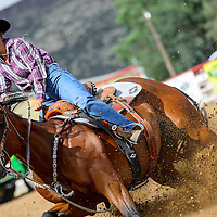 081713  Adron Gardner/Independent<br /> <br /> The horse of Sheri Estrada plows into a turn on a 16.640 ride during day one of the Leo Mitchell Jr. Memorial 4D Barrel Race at the Grants Rodeo grounds in Grants Saturday.