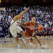 UNCASVILLE, CONNECTICUT- DECEMBER 4:  Brooke McCarty #11 of the Texas Longhorns drives to the basket while defended by Gabby Williams #15 of the Connecticut Huskies during the UConn Huskies Vs Texas Longhorns, NCAA Women's Basketball game in the Jimmy V Classic on December 4th, 2016 at the Mohegan Sun Arena, Uncasville, Connecticut. (Photo by Tim Clayton/Corbis via Getty Images)