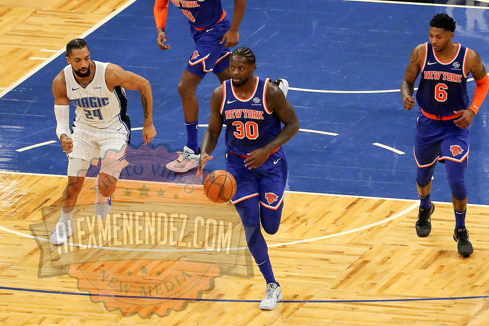 ORLANDO, FL - FEBRUARY 17:  Julius Randle #30 of the New York Knicks breaks away from Khem Birch #24 of the Orlando Magic at Amway Center on February 17, 2021 in Orlando, Florida. NOTE TO USER: User expressly acknowledges and agrees that, by downloading and or using this photograph, User is consenting to the terms and conditions of the Getty Images License Agreement. (Photo by Alex Menendez/Getty Images)*** Local Caption *** Julius Randle; Khem Birch