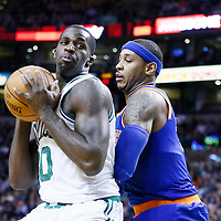 24 January 2013: Boston Celtics power forward Brandon Bass (30) posts up New York Knicks small forward Carmelo Anthony (7) during the New York Knicks 89-86 victory over the  at the TD Garden, Boston, Massachusetts, USA.
