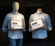 Positive messages during Covid coronavirus lockdown held by mannequins in shop window, UK - Keep Growing, Keep Caring