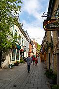 Tourists enjoy a morning walk along Rue du Petit Champlain, Quebec, Canada.