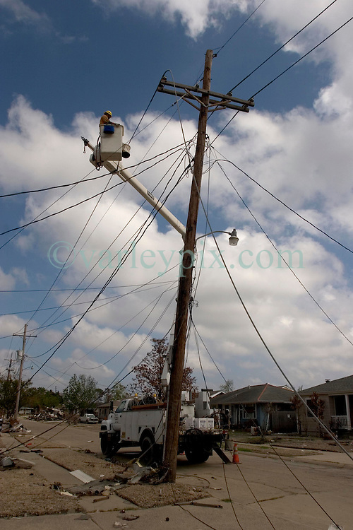 04 Oct, 2005. New Orleans, Louisiana. Hurricane Katrina aftermath. <br /> Private contractor telephone and power engineers work to restore services amidst the smashed homes in the Arabi neighbourhood. <br /> Photo; ©Charlie Varley/varleypix.com
